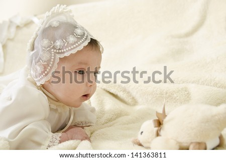 baby with ceremonial clothes, high key image. - stock photo
