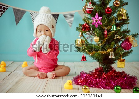 Baby with christmas background - stock photo