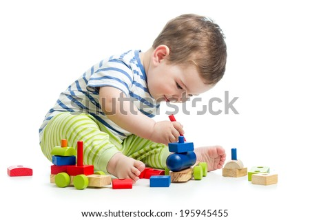 baby with construction set isolated on white background - stock photo