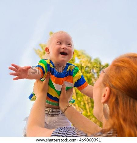 Baby with Down syndrome is happy and flying up