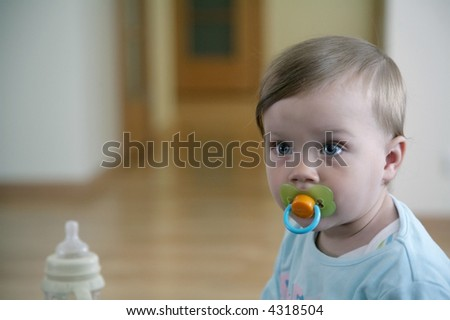 baby with dummy - stock photo
