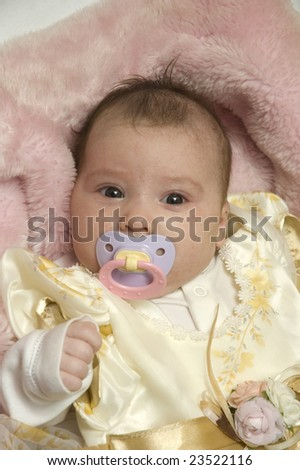 Baby with dummy in mouth