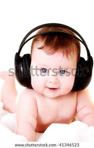 baby with earphones - stock photo