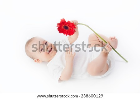 baby with flower - stock photo