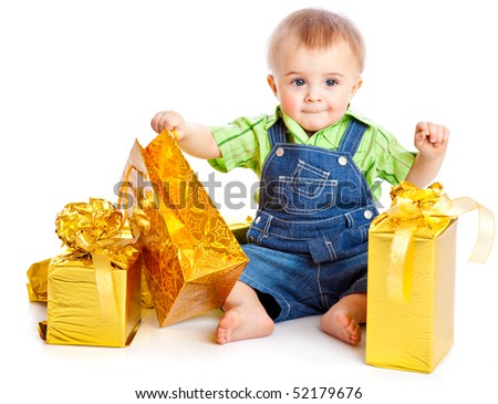 Baby with gifts. Isolated on white background - stock photo