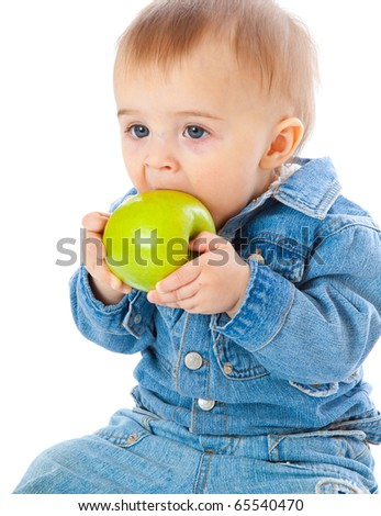 Baby with green apple. Isolated on white background