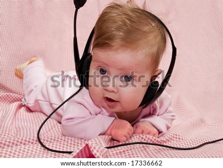 baby with headphones - stock photo