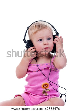 Baby with headphones, isolated on a white background - stock photo