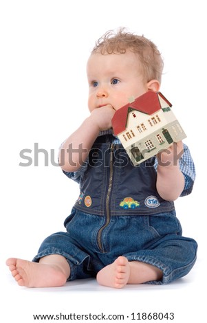 baby with house model  on white