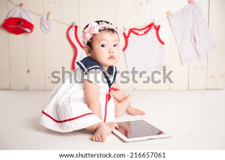 baby with laptop confused - stock photo