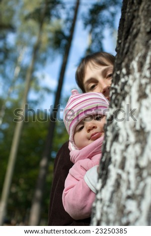 Baby with mom in the forest