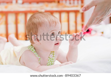 baby with mother indoor - stock photo