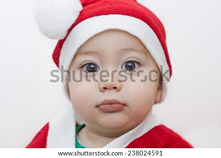 baby with one year old santa claus dress - stock photo