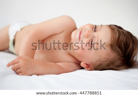Baby with one years old getting out of bed doing gestures - stock photo