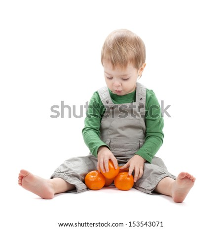Baby with oranges. Isolated on white background