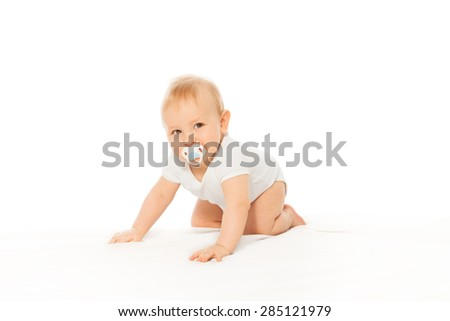 Baby with pacifier in his mouth wear white bodysuit