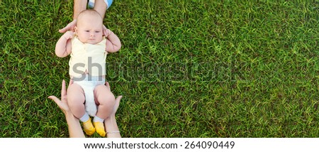 baby with parents care - stock photo