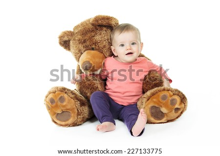 Baby with plush - stock photo