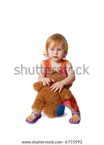 baby with pot and toy