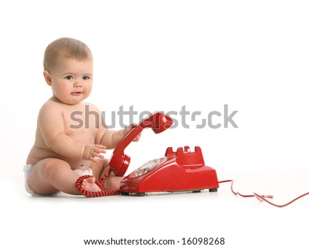Baby with red phone on white background - stock photo
