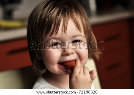 baby with sausage - stock photo