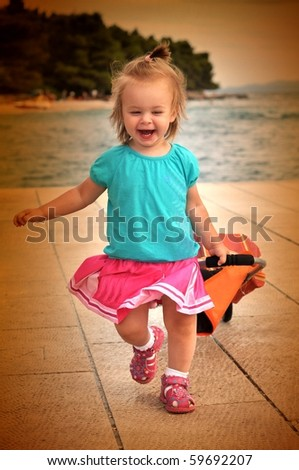 baby with shopping bag - stock photo