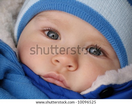 Baby with the big blue eyes - stock photo