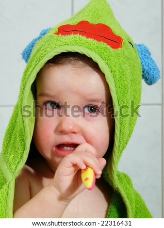 Baby with toothbrush - stock photo