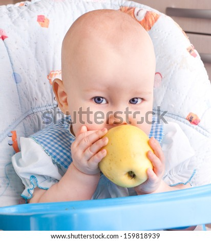 Baby with yellow apple, newborn baby