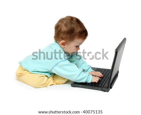 baby working on laptop on white background - stock photo