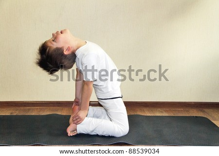 Baby yoga at home - stock photo