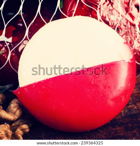 Babybel cheese in red wax close up on the table - stock photo