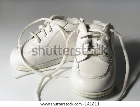 babyshoes on gray background