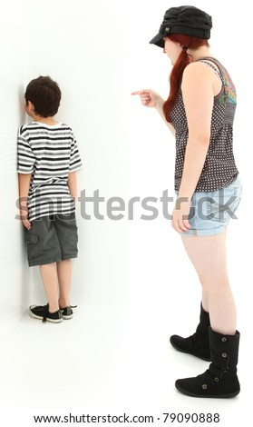 Babysitter punishing child with nose on wall in corner. - stock photo
