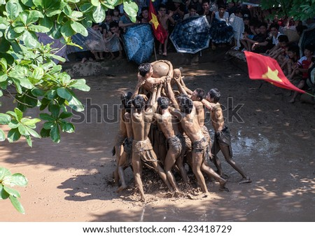 BAC GIANG, VIET NAM, May 20, 2016 man team, Van village, Bac Giang, Vietnam. participate in the festival competition ball, traditional materials, on the mud, very unique, the legacy of Vietnam