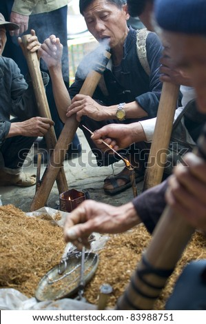 BAC HA,VIETNAM-MAY 29:Local people smoke bong in Bac Ha, Vietnam on May 29, 2011.Smoking bong (marijuana) in Vietnam is legal.