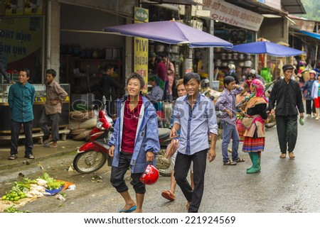 BAC HA, VIETNAM - SEP 21, 2014: Unidentified people  at the Bac Ha Market, a large Sunday market with people wearing beautiful colored minorities costumes