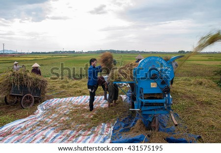BAC Ninh, Vietnam, May 4, 2016 FG Bac Ninh, rice harvesting, threshing machines, in fields
