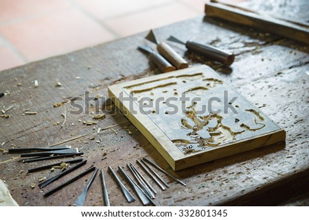 Bac Ninh, Vietnam - Sep 9, 2015: Wooden painting is being made in workshop by craftsman in Dong Ho folk painting village