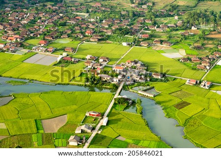 BAC SON, VIETNAM - JULY 10: Aerial view of  residential area on July 10, 2014 in Bac Son, Vietnam where the main career of the local people is agriculture. - stock photo