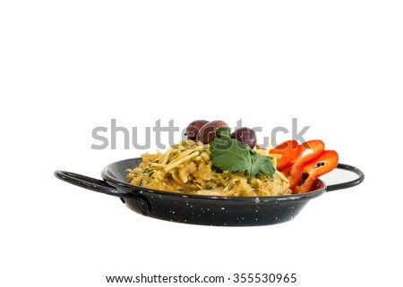 bacalhau a bras, fried codfish with eggs and onion portuguese traditional dish on white background