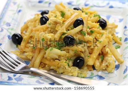 bacalhau a bras, Portuguese cuisine, a dish with salt cod, potatoes and eggs - stock photo