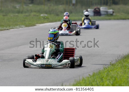 BACAU, ROMANIA - JULY 17: Roberto Arcarese, number 409, competes in National Karting Championship, Round 3, on JULY 17, 2011 in Bacau, Romania.