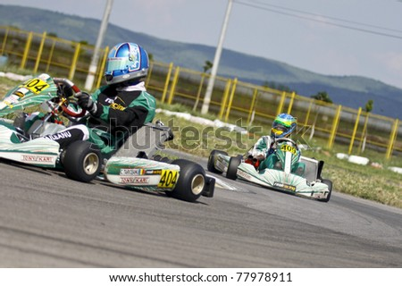 BACAU, ROMANIA - MAY 21: Roberto Arcarese number 409, competes in National Karting Championship, Round 2, on May 21, 2011 in Bacau, Romania.