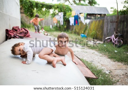 BACAU, ROMANIA - SEPTEMBER 10, 2014. Unidentified children living in poverty in the little villages near BACAU, ROMANIA.