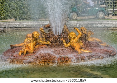 Bacchus Fountain (or Autumn fountain) in gardens of famous Versailles palace. Palace of Versailles was a royal chateau. It was added to UNESCO list of World Heritage Sites. Paris, France. - stock photo