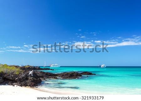Bacha Beach and pristine water on Santa Cruz island in the Galapagos Island in Ecuador - stock photo