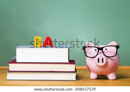 Bachelor of Arts degree theme with textbooks and piggy bank and green chalkboard - stock photo