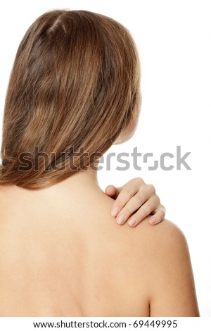 Back ache massage - caucasian woman with backache from behind. - stock photo