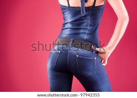 Back and ass of beautiful woman over red background - stock photo